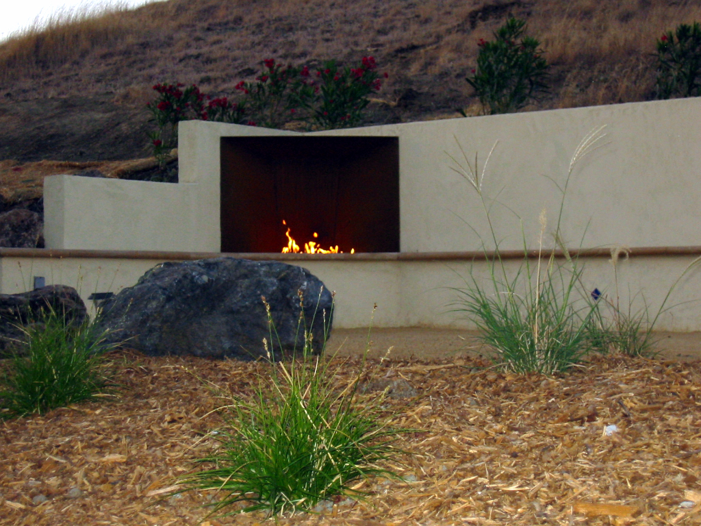Wood burning fireplace with Corten Steel, built into bench