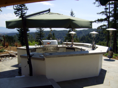 Concrete countertops on octagonal outdoor kitchen with raised bar
