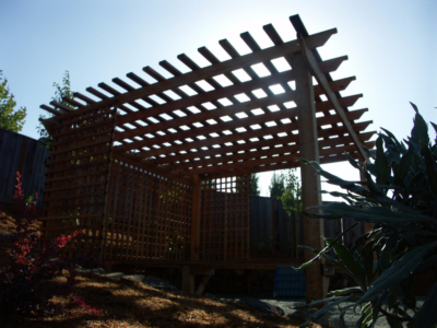 Wooden arbor provides shade, privacy and something for vines to grow on.