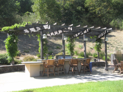 Outdoor bar in front of professional outdoor kitchen