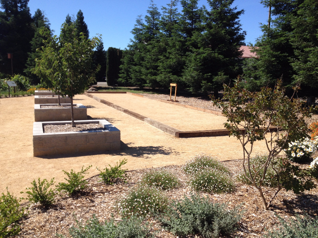 Bocce ball court at winery using railroad ties, decomposed granite