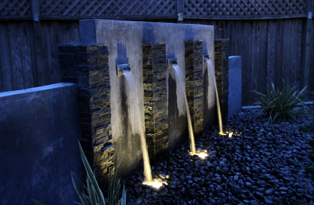 Water feature in Sonoma County shines after sunset with custom lighting