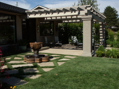 Arbor provides shade for backyard sitting area in Sonoma County