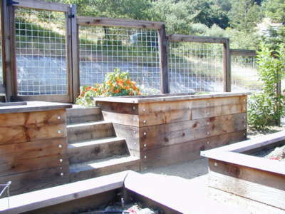 Custom stairs, raised veggie beds and hogwire fence create potential for a fabulous vegetable garden in Sonoma County